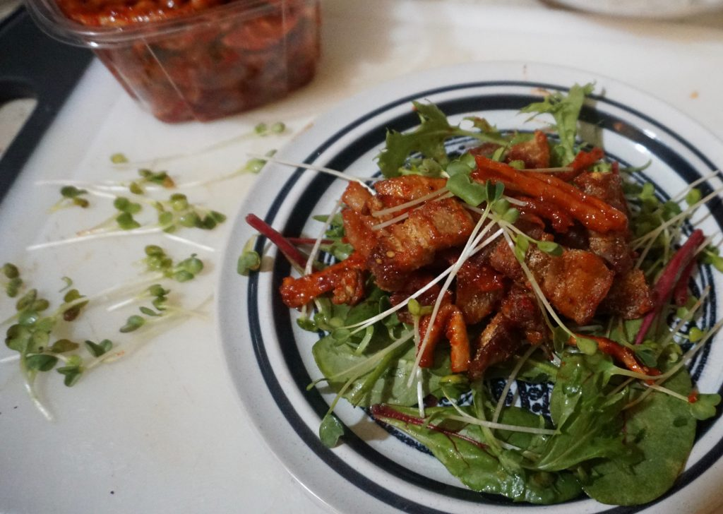 American Southern Fusion Salad recipe with fresh hot cracklin's, radish kimchi and spinach`